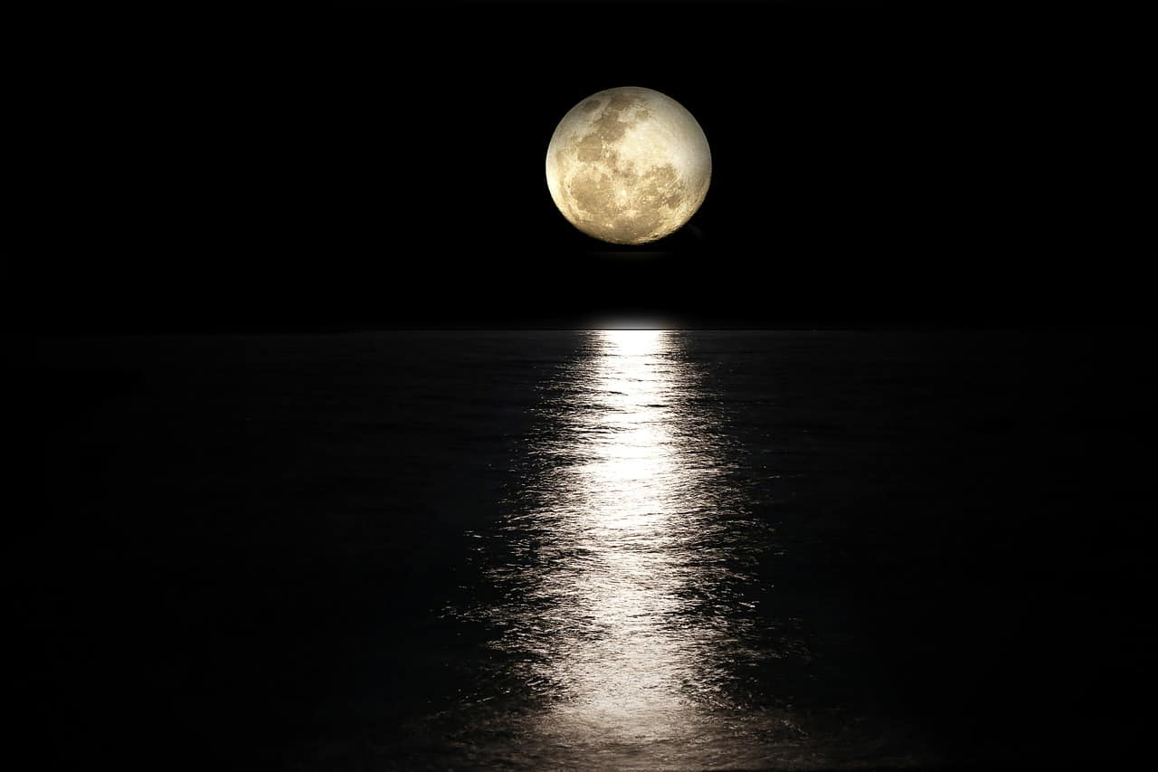 photo of the moons reflection over water
