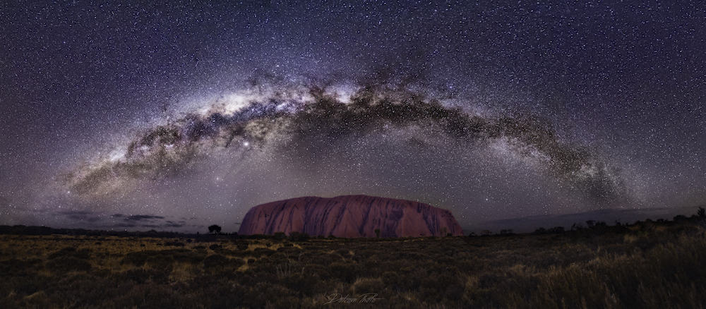 composition shot of the milky way over a landmark